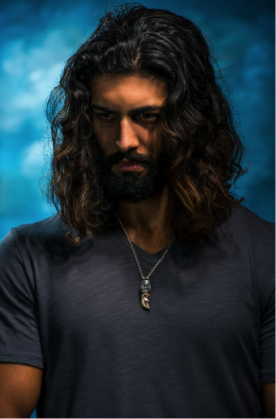 man with long hair wearing william henry necklace
