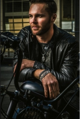motorcycle rider wearing william henry bracelet and necklace