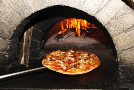pizza in wood fired stone oven
