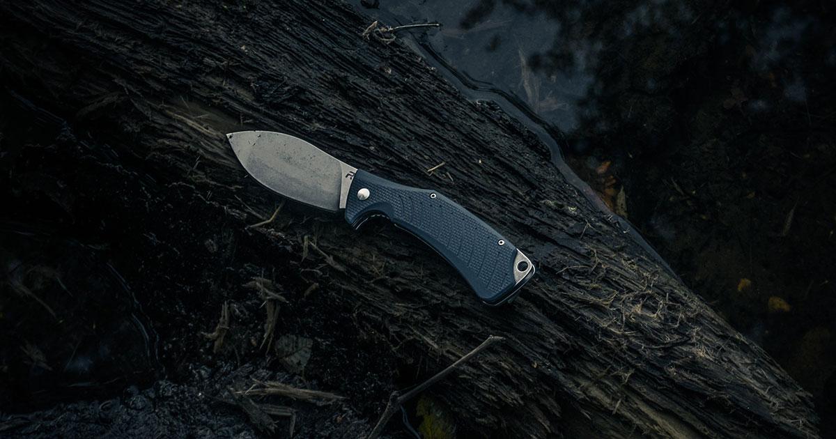 Pocket Knife on a Log
